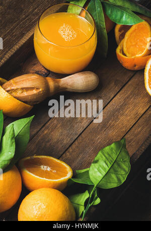 Glass of freshly squeezed juice and fresh oranges - Stock Photo