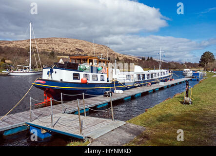 Barge Scottish Highlander moored in the Caledonian Canal basin at Banavie near Fort William in Highland Scotland - Stock Photo