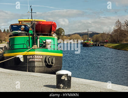 Barges Ros Crana and Fingal moored in the Caledonian Canal basin at Banavie near Fort William in Highland Scotland - Stock Photo