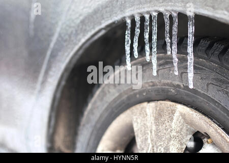 car in a winter morning with snow covered - Stock Photo