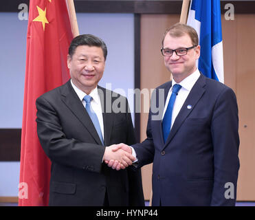 Helsinki, Finland. 5th Apr, 2017. Chinese President Xi Jinping (L) meets with Finnish Prime Minister Juha Sipila - Stock Photo