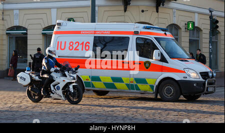 Helsinki, Finland. 5th April, 2017. Motorcycle policeman and intensive care ambulance secure the safety of President - Stock Photo