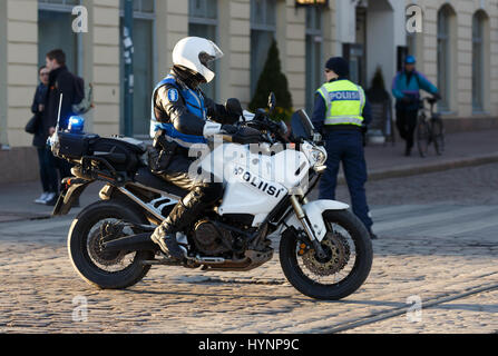 Helsinki, Finland. 5th April, 2017. Motorcycle policeman secures the safety of President Xi Jinping Credit: Hannu - Stock Photo