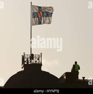 Helsinki, Finland. 5th April, 2017. Police observer on a rooftop works for the security arrangements in Helsinki - Stock Photo