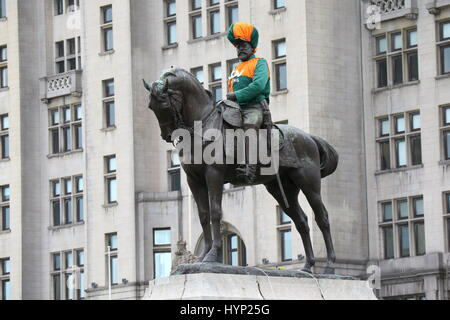 Liverpool, UK. 6th Apr, 2017. King Edward VII monument at pier head Liverpool decked out in jockey racing colours - Stock Photo