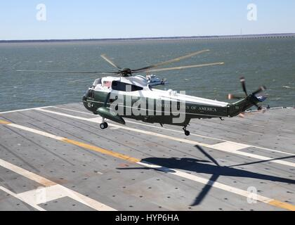 Marine One helicopter carrying U.S. President Donald Trump lands aboard the USN Gerald R. Ford-class aircraft carrier - Stock Photo