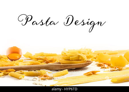 Various types of pasta with flour and an egg, on white background with a place for text - Stock Photo