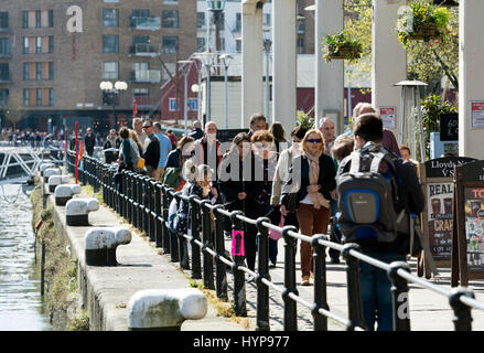 People walking about on a sunny day by St. Augustine`s Reach, Bristol, UK - Stock Photo