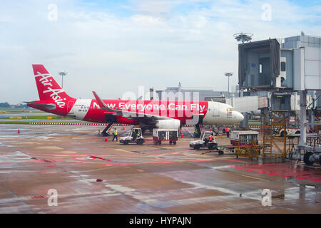 SINGAPORE - FEB 15, 2017: AirAsia aircraft in Changi International Airport during unloading baggage. Changi is the - Stock Photo