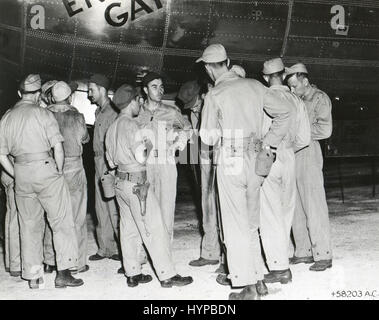 Crew of ENOLA GAY receives last-minute instructions from Col Paul Tibbets (center) before taking off on the historical - Stock Photo