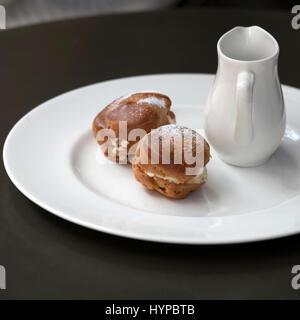 Red Glazed Cake With Chocolate Ganache On Plate
