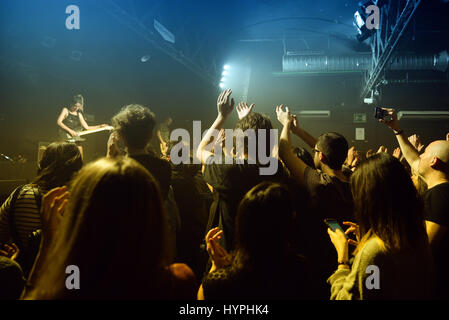 BARCELONA - FEB 6: Crowd clapping in a concert at Razzmatazz stage on February 6, 2016 in Barcelona, Spain. - Stock Photo