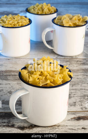 dried pasta in metal cup reginelle front - Stock Photo