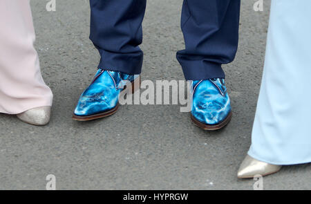 A view of a racegoers shoes during day one of the Randox Health Grand National Festival at Aintree Racecourse. PRESS - Stock Photo