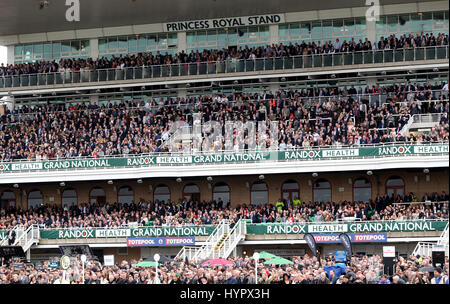 Crowds in the Princess Royal stand during day one of the Randox Health Grand National Festival at Aintree Racecourse. - Stock Photo