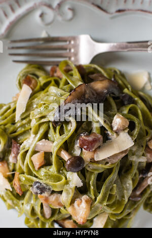 Green Spinach Pasta Tagliatelle with Bacon, Brown Shimeji Mushrooms and Parmesan Cheese - Stock Photo