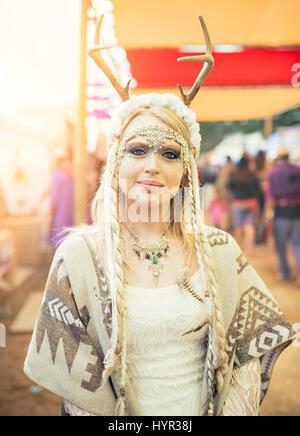 Female music festival attendee in costume. - Stock Photo