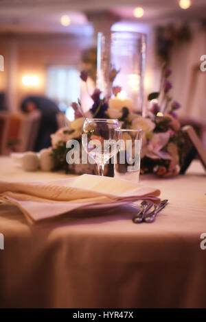 Glass wine glasses on the table served in the restaurant - Stock Photo