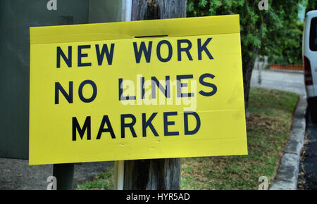 Road sign saying 'New Work No Lines Marked' warning road users and drivers in Australia. - Stock Photo