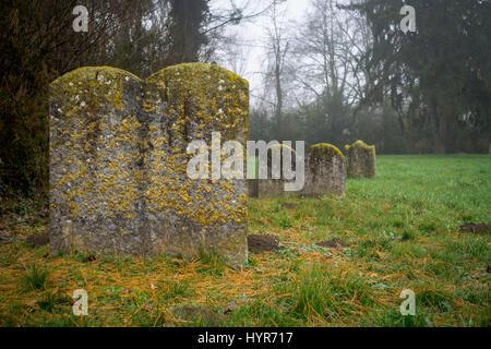 Old gravestones in Jewish cemetery - Stock Photo