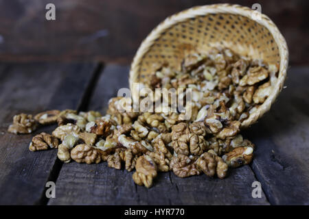 peeled walnut on a wooden background - Stock Photo