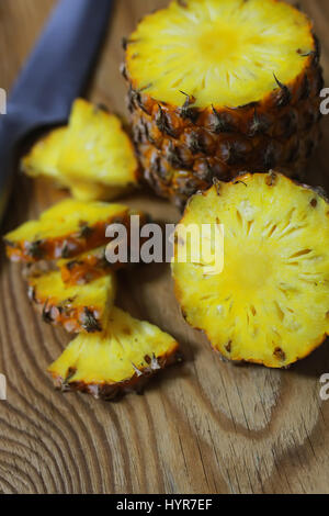 pineapple slices cut knife - Stock Photo