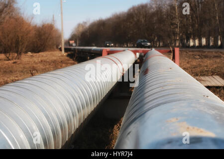 silver pipes oil outside - Stock Photo