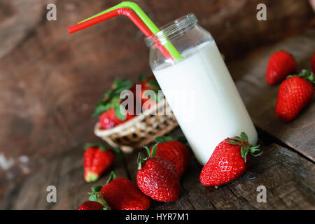 strawberries and milk in a glass - Stock Photo