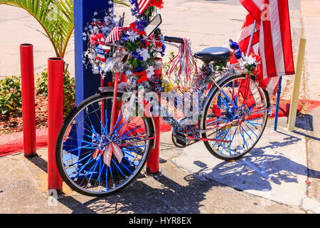 Bicycle covered in red, white and blue and the stars and stripes American flag in downtown Tarpon Springs, Florida. - Stock Photo