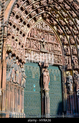 Strasbourg, Notre-Dame gothic cathedral 14th century, main portal and tympanum, jamb statues, Virgin Mary with child - Stock Photo