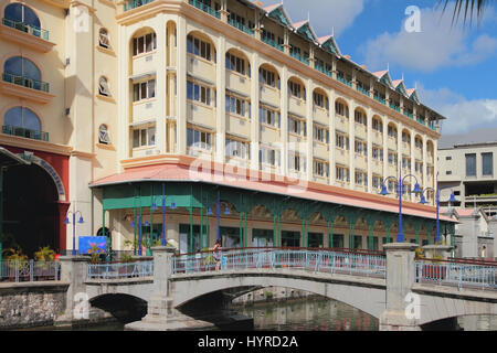 Hotel, pedestrian bridge, channel. Port Louis, Mauritius - Stock Photo