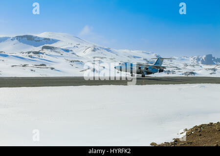 Regional airliner British Aerospace BAe 146 landing at Teniente R. Marsh Airport, King George Island, Antarctica - Stock Photo