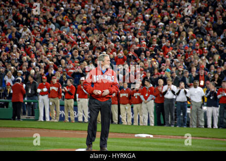 U.S. President George W. Bush pitches the first ball for the Washington Nationals during the Inaugural Game at Nationals - Stock Photo