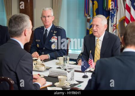 U.S. Secretary of Defense James Mattis speaks with NATO Secretary General Jens Stoltenberg during a meeting at the - Stock Photo