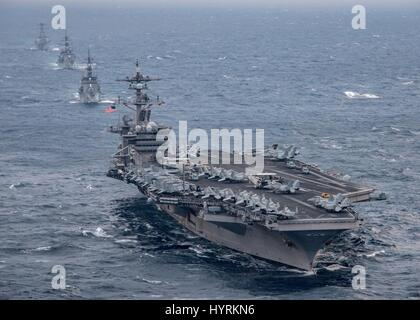 The USN Nimitz-class aircraft carrier USS Carl Vinson leads a formation of U.S. and Japanese guided-missile destroyers - Stock Photo