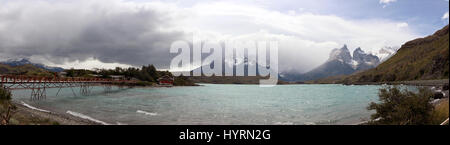 Stunning very wide panoramic view of mountains with a lake - Stock Photo