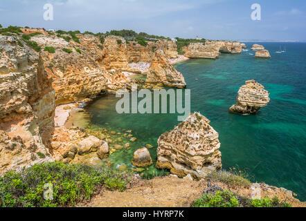 Scenic cliffs near praia da Marinha, Carvoeiro, Algarve - Stock Photo