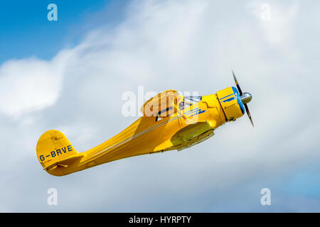 Beech D-17S Staggerwing flying on July 1st 2012 at Duxford, Cambridgeshire, UK - Stock Photo