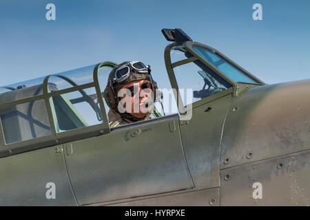 Hawker Hurricane pilot in his aircraft on July 13th 2013 at Duxford, Cambridgeshire, UK - Stock Photo