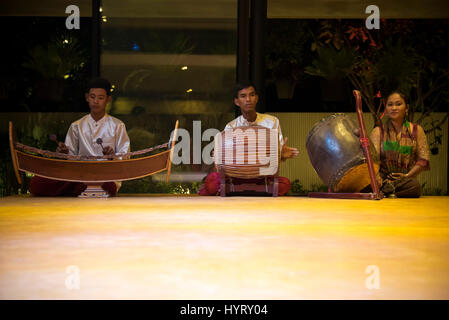 Horizontal portrait of traditional musical instruments being played at an Apsara - Stock Photo