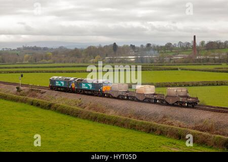 Nuclear waste transported in transport cabin containing a nuclear waste flask by Direct Rail Services Class 57 freight - Stock Photo