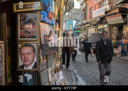 ISTANBUL, TURKEY - DECEMBER 28, 2015: People passing by portraits of Kemal Ataturk and Recep Tayyip Erdogan, current - Stock Photo