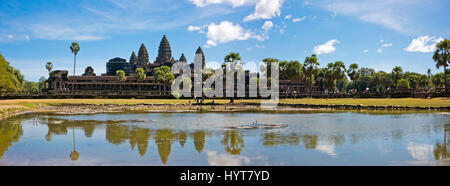 Horizontal panoramic (3 picture stitch) view of Angkor Wat in Cambodia. - Stock Photo