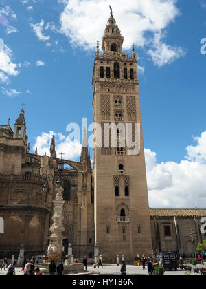 4f91e53b4 ... View looking up at the Giralda bell tower of Seville Cathedral in Spain  - Stock Photo