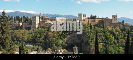 A panoramic view of the Alhambra Palace with Sierra Nevada in the background seen from Mirador de San Nicolas - Stock Photo