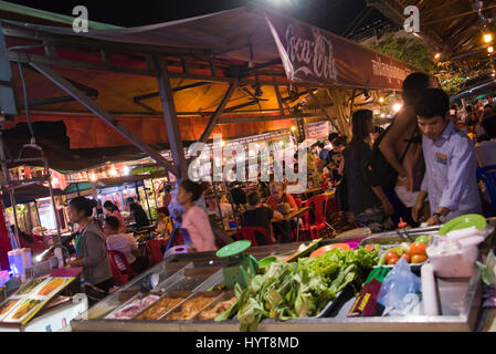 Horizontal view of a busy street food outlet in Siem Reap, Cambodia at night. - Stock Photo