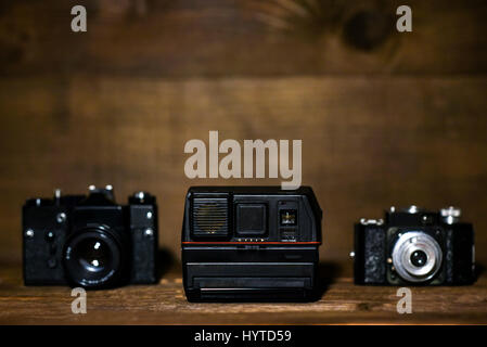 Olda cameras on a wooden background with copy space - Stock Photo
