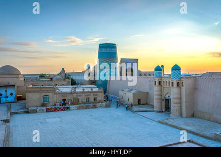 Khiva old town with city wall and minaret in sunset, Uzbekistan - Stock Photo