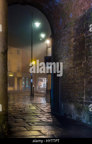 Birdcage Walk looking out from the abbey towards the Market Cross in the Wiltshire town of Malmesbury - Stock Photo