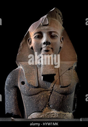 The Younger Memnon Head and upper body of monumental statue of Ramses II (one of a pair placed before the door of - Stock Photo